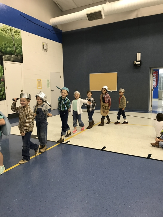 All dressed up like Johnny Appleseed! K-1 listened to a story about John Chapman, a real frontier hero.